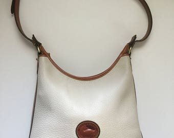 Vintage Dooney and Bourke beige and tan cross body purse
