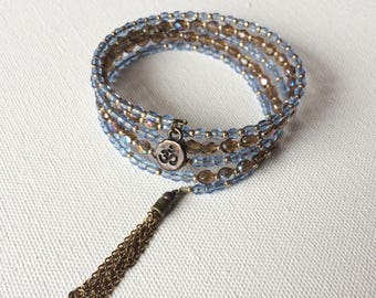 Light sapphire and smoky topaz 5 wrap bracelet with tassel and OM charm