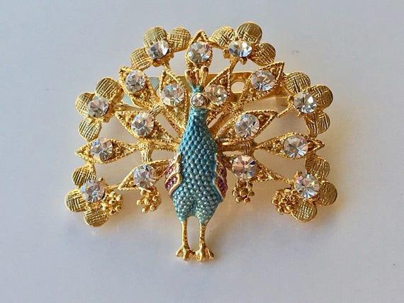 Lovely vintage goldtone blue enamel diamante peacock brooch
