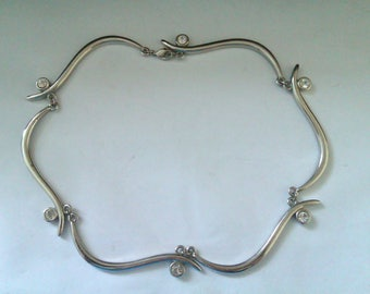 silver coloured nouveau style necklace
