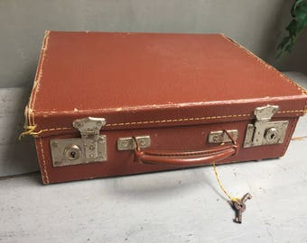 Small square suitcase, vintage, old luggage suitcase