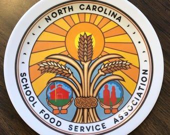 "Vintage North Carolina School Food Service Association Melamine Plate with Wheat and Sun Design | 10.25"" Diameter"