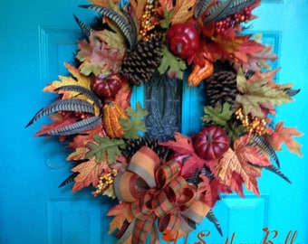 FALL STARBURST WREATH, Fall Leaves, berries, gourds, feathers, and pinecones, fall colors of oranges, yellows, browns, fall bow, Door wreath