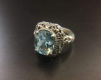 Ornate Sterling silver filigree ring with blue topaz, size 8, weight 6 grams