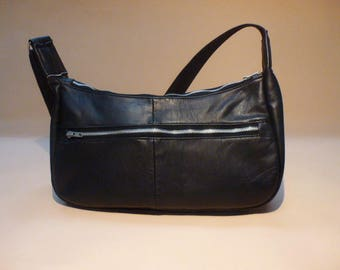 a large black recycled leather shoulder bag