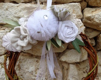Shabby chic and romantic with flowers in linen tassel tulle and twigs of vine wreath