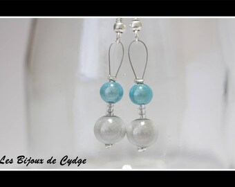 Earrings and her magical turquoise beads and white