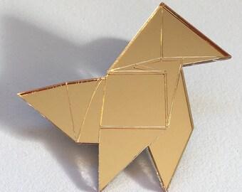 Golden origami brooch