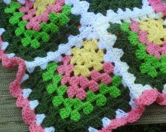 Doll Blanket crocheted with pink,yellow,lime green and dark sage green for any little doll or a child's lap blanket.