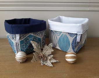 Basket of storage in different fabrics on the outside and fabric plain on the inside