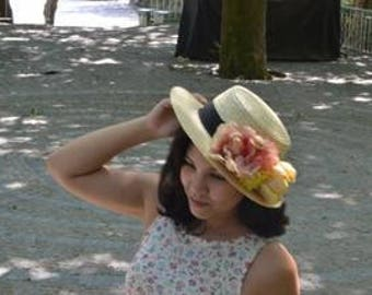 Boater hat with flowers in pink and yellow