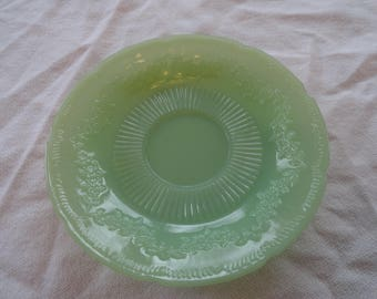 12 Fire King Jadeite saucers in the Alice pattern