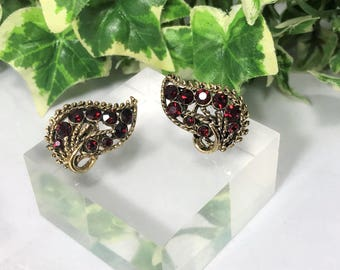 A Lovely Pair of Signed Weiss Vintage Clip On Earrings, Red Crystals and Gold Tone. 1950's