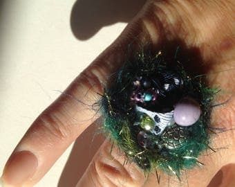 Original ring in wool, beads and buttons.