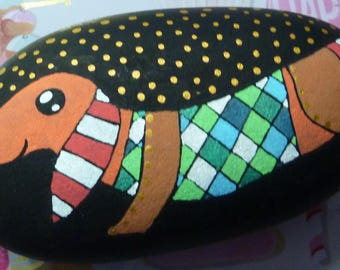 Pebble paperweight depicting a dog hand painted