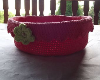 Basket with cotton yarn hand crocheted rose with green crocheted flower