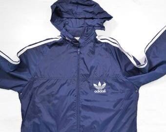 Vintage 80s Adidas Women's Trefoil windbreaker jacket Big logo Spell out Navy Blue/White  Size L