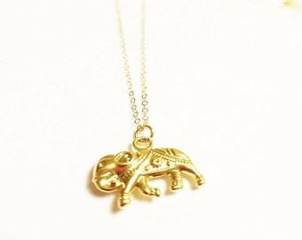 Dainty 14 kt gold elephant pendant