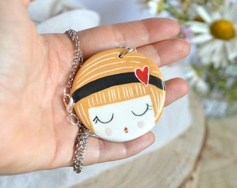 Little blond girl face necklace with pin-up style, handmade ceramic pendant