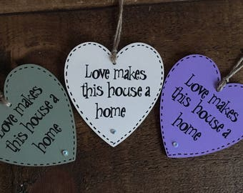 Love makes this house a home - Wooden Hanging Heart - Encouraging Words