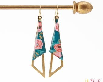 Earrings are made of resinees blue floral pattern