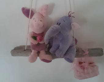 Carefree childhood. Swing and its fluff mounts and baby booties