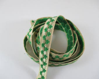 Fancy, ornate, colors are cream and Green Ribbon braid, width 13 mm.