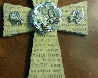 Stone jeweled cross. Love is kind. Love never fails.