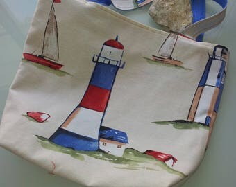 A lighthouse. Tote bag printed three pockets lined blue