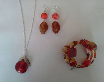 set three piece glass beads of red and honey