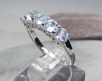Silver knuckle ring and Blue Topaz size 58