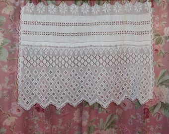 Antique openwork fabric and old lace curtain