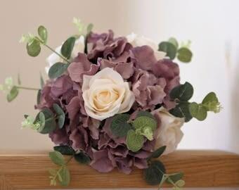 Medium size Artificial flower wedding bouquet. Mauve hydrangea flowers and cream roses.