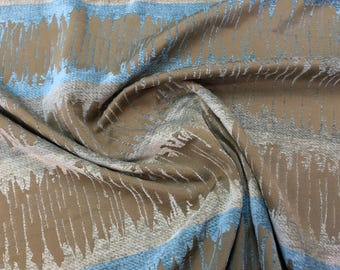 Elegant Repeated Blue, Silver and Gray Velvet Finish Markings On Woven Brown Mid-Weight Cotton Blend