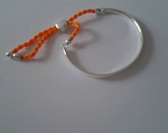 Bracelet half ring color silver with an orange cord