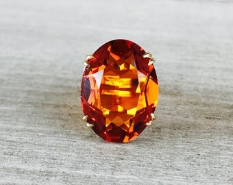 Bright orange glass stone vintage ring in yellow gold