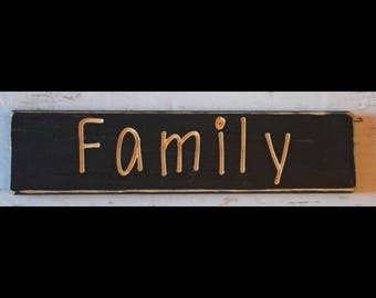 Family carved wooden sign