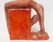 Yoga statue, figurine, sculpture, carving, nude figure, reclining on an orange cube ,box  ceramic glazed hand made original unique woman