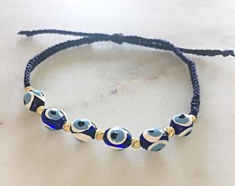 Evil eye friendship bracelet with gold beads
