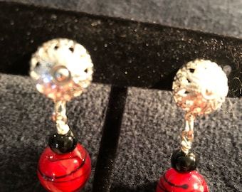 Red clip on earrings