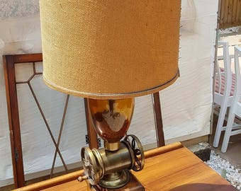 A brass hardwood and glass coffee grinder table lamp ONE OF A KIND