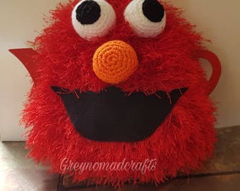 This happy Elmo teapot cosey is a real brighten up your day little character.