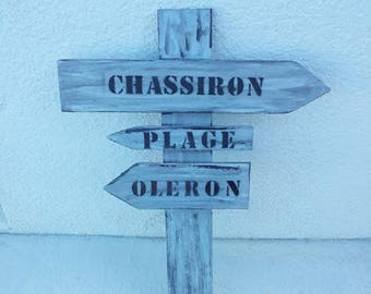 painted and varnished wooden arrow signs