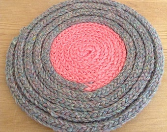 Pink and grey woollen coaster / placemat
