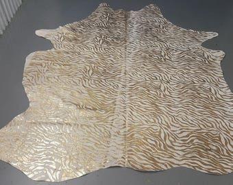 printed cow hide rug metallic gold on white brazilian