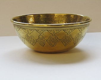 Etched brass bowl with arabic patterns