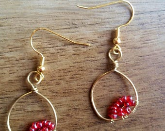 Gold plated hoop earrings with red beads