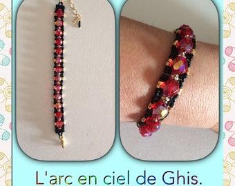 Black, red, gold chain bracelet.