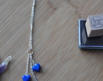 Three blue resin hearts with glitter necklace