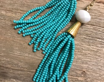 Handmade teal beaded tassel earrings!